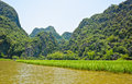 Limestone mountains with rice field on front Stock Images