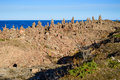 Limestone towers in multitude are erected in a quarry on the island of oland sweden tower after tower rise with the horizon in the Stock Images