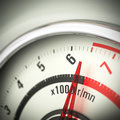 Limit engine speed rev counter close up of a tachometer with blur effect and the needle pointing just below the red Royalty Free Stock Photo