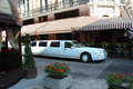 Limousine standing besides caffe in lvov white Royalty Free Stock Images