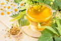 Linden and chamomile flowers and cup of healthy tea herbal medicine Stock Photo