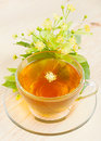 Linden flowers and cup of healthy tea herbal medicine Royalty Free Stock Photo
