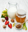 Linden honey and milk on a old wooden background Stock Photos