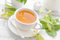 Linden tea with flowers and leaves Royalty Free Stock Photo