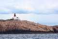 Lindesnes fyr lighthouse in norway may on the peninsula neset photographed from the sea on may at this is Royalty Free Stock Images