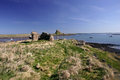 Lindisfarne castle with the harbour in the foreground Stock Photo