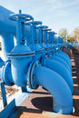Line from blue oxigen gate valves with pipes Stock Image