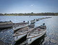Line of boats afloat in a reservoir kent uk on bewl water high weald Stock Image
