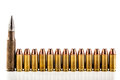 Line of bullets a lot mm arranged in a row and isolated over a white background Royalty Free Stock Photography