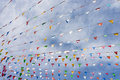 Line of colorful festival flags Royalty Free Stock Photo