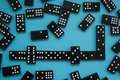 Line of domino pieces on the blue background, view from top Royalty Free Stock Photo