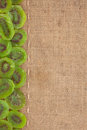 Line dried kiwi and burlap for the menu can be used as background Royalty Free Stock Image