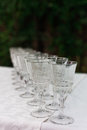 The line of empty stemware at the table in restaurant close up Royalty Free Stock Photo