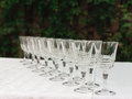 The line of empty stemware at the table in restaurant close up Stock Photos