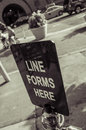 Line forms here sign in front of an italian restaurant in brooklyn new york Royalty Free Stock Image