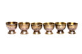 Line of golden cups Royalty Free Stock Photo