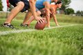 At the line guys playing flag football on a warm autumn day Stock Photography