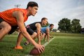At the line guys playing flag football on a warm autumn day Royalty Free Stock Images