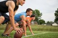 At the line guys playing flag football on a warm autumn day Stock Images