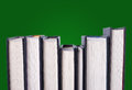 Line of hardcover books row in a green background Stock Photography