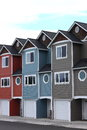 Line of homes a colorful attached identical modern with lots windows Royalty Free Stock Image