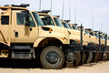 Line of military transportation trucks Royalty Free Stock Images