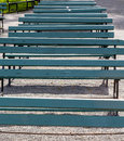 Line of Old Green Benches Royalty Free Stock Photo