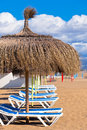Line of parasols at spanish sand beach vertical shot Stock Images