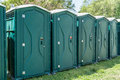 Line of Portable Toilets Royalty Free Stock Photo