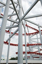 Line of red roller coaster rail structure Stock Photography