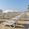 Line of sun beds and Umbrellas on a Larnaca beach Royalty Free Stock Photo