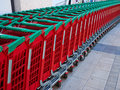 Line of supermarket shopping cart trolley Royalty Free Stock Photo