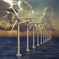 Line of wind generators at sea farm or with sky Royalty Free Stock Photography