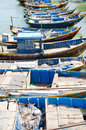 Line wooden blue fishing boats vietnam Stock Image