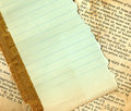 Lined paper on an antique book Stock Photo