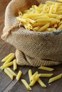 Linen bag of pasta (penne) Royalty Free Stock Photo