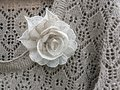 Linen knitted shirt and flower brooch Royalty Free Stock Photo