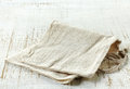 Linen napkin on old wooden table Stock Image