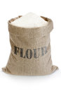 Linen sack with flour full of isolated on white background Royalty Free Stock Photo