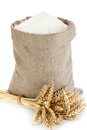 Linen sack with flour full of and wheat spike isolated on white background Stock Photos