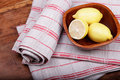 Linen tea towel and lemons. Stock Images