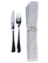 Linen textile napkin with cutlery knife and fork serving tabl table setting in silver grey color isolated on white background Royalty Free Stock Image