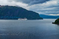 Liner in fjord stordal norway Royalty Free Stock Images