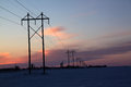 Lines at sunset telephone along a road in the winter Stock Photos