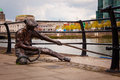 The linesman statue on river liffey in dublin city Stock Photos