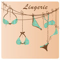 Lingerie a set of colored bras and panties with some text Royalty Free Stock Photo