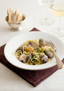 Linguine with clams in a white wine sauce parsley Stock Photography