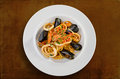 Linguine seafood on white plate isolated Stock Photo