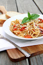 Linguine with tomatoes bowl of and basil Stock Photo