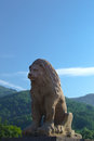 Lion in the carpathians stone against fine mountains morning a figure Stock Image